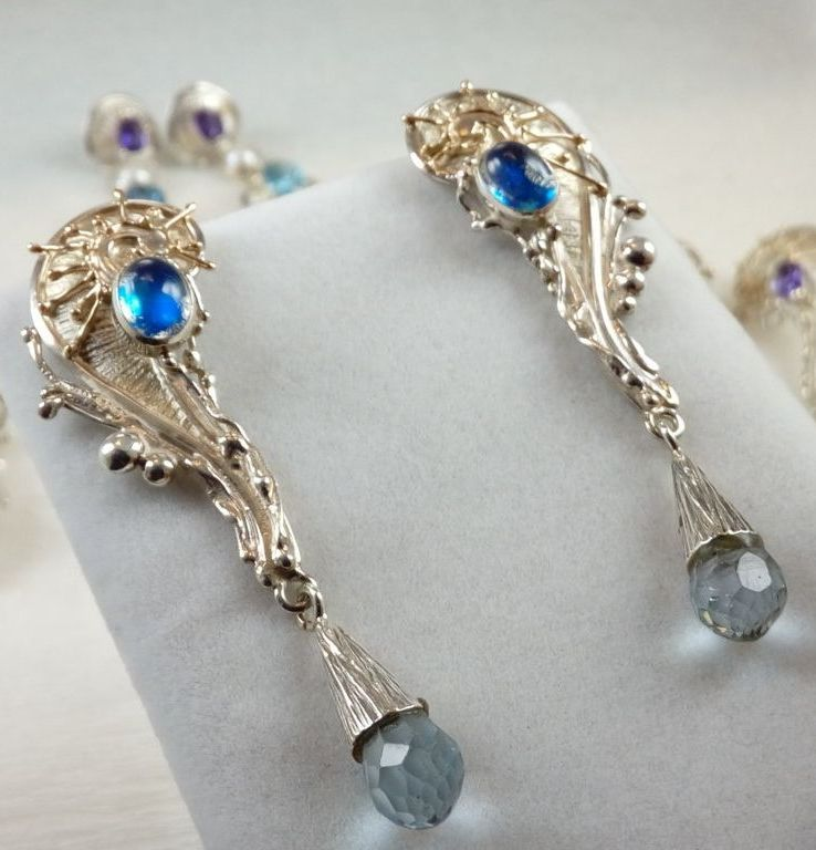 fine craft gallery earrings for sale, fine craft gallery artisan jewellery for sale, gregory pyra piro handcrafted earrings 8321, silver and gold earrings with moonstone and blue topaz, reticulated and soldered jewellery with faceted gemstones, silver and gold reticulated jewellery