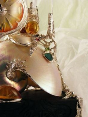 Gregory Pyra Piro Clock Sculpture in Oakwood, Sterling Silver, 14 Karat Gold, and Enamel with Nautilus Shell, Drusy, Amber, Facet Cut Garnet, Facet Cut Peridot, and Pearls